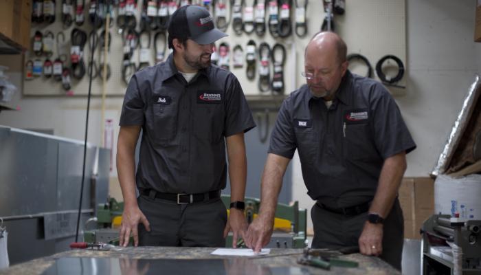 Bensons Technicians In Warehouse Sheetmetal